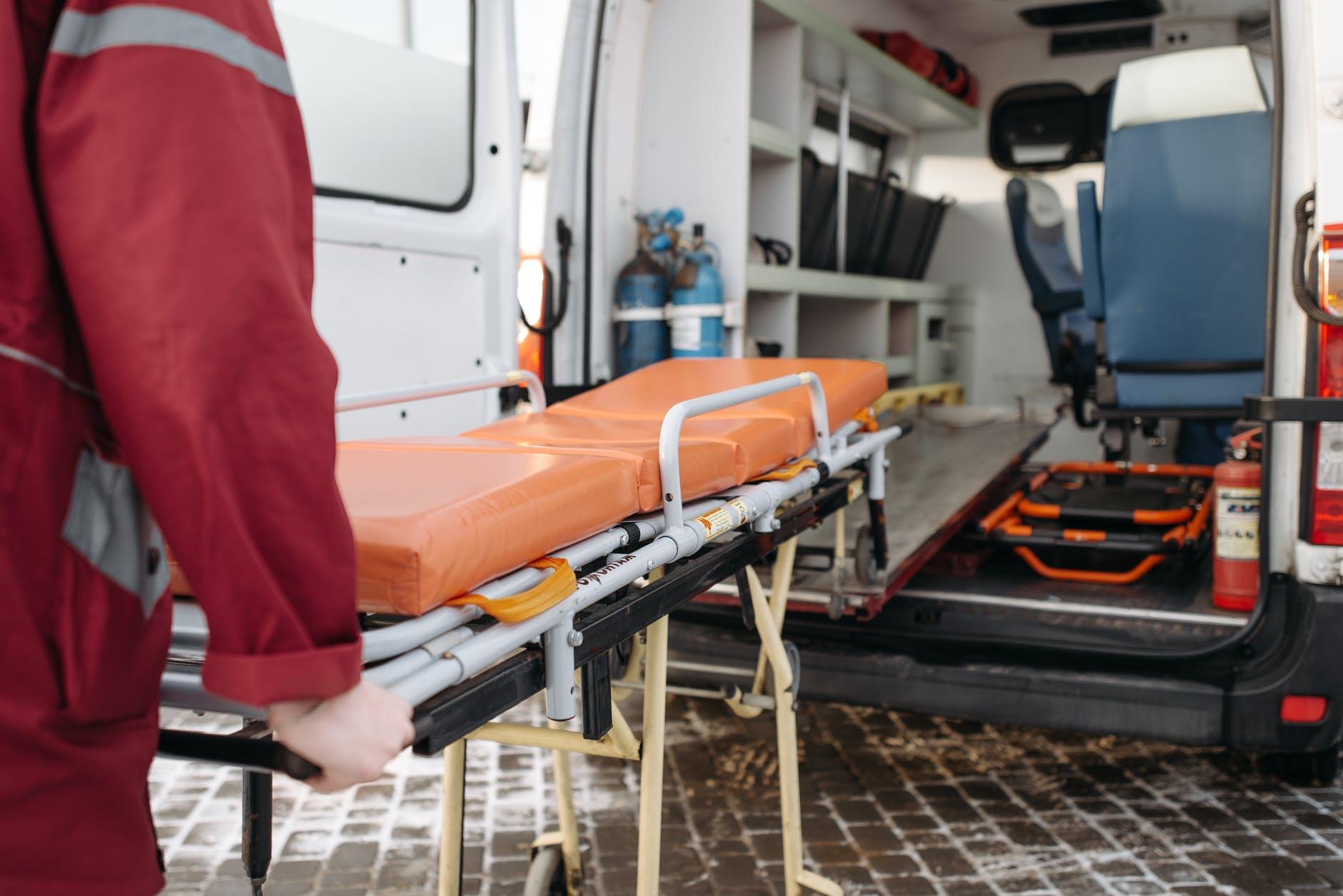 man pushing a stretcher